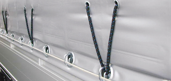Tarp/curtain buckles for board wall vehicles